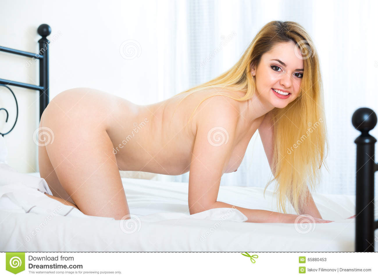 Nude girl in bed