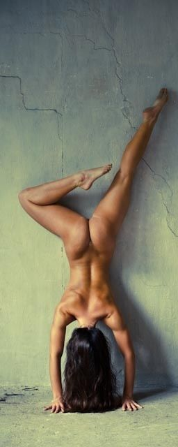 Female naked hand stands